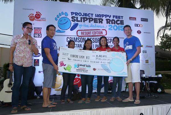 PHF Director of Communications Terence Quek presenting a mock cheque to representatives of Bantay Bata 163 together with Crimson Resort & Spa Mactan's Director of Rooms
